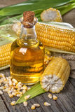 Corn with corn oil. Freshly picked domestic corn with corn oil Stock Images