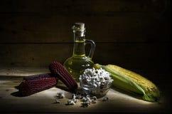 Corn and corn oil. Still life with corn, popcorn and corn oil Stock Photos