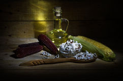 Corn and corn oil. Still life with corn, popcorn and corn oil Royalty Free Stock Images