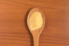 Corn Couscous into a spoon. Cuscus Stock Photography