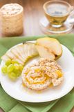 Corn crackers with honey and fruits Royalty Free Stock Images