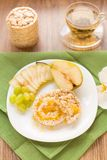 Corn crackers with honey and fruits Royalty Free Stock Photography