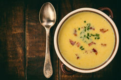 Corn cream soup with bacon chowder on wooden background. Royalty Free Stock Photo