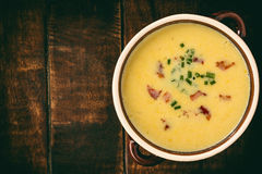Corn cream soup with bacon chowder on wooden background. Stock Image