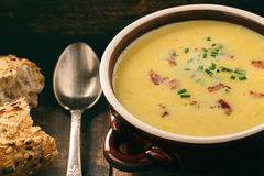 Corn cream soup with bacon chowder on wooden background. Stock Photo