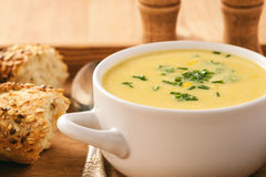 Corn cream soup with bacon chowder on wooden background. Royalty Free Stock Photos