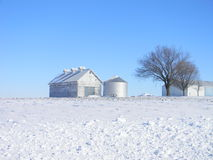 Corn Crib in winter. Corn crib and silo in the dead of winter surrounded by white snow Stock Photography