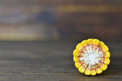 Corn cross section on wooden background Stock Images