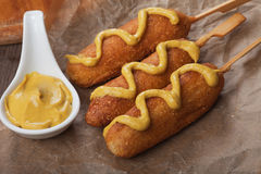 Corn dog with mustard Stock Photo