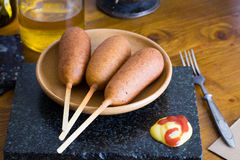 Corn dog on a table, ketchup, mustard, Still Life home, sausage, breaded, yummy, delicious Royalty Free Stock Photos