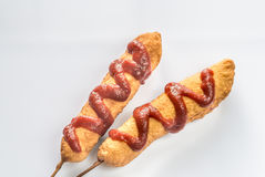 Corn dogs on the white background Royalty Free Stock Image