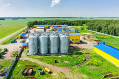 Corn dryer silos standing in machine yard Royalty Free Stock Image