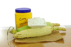 Corn ear and corn starch. In dish and container stock images