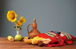 Corn in ethnic bags, sunflower and apple Royalty Free Stock Image