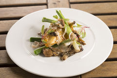Corn fed chicken with mushrooms. Corn fed chicken with cider, baby leeks & wild mushrooms Royalty Free Stock Images