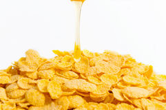 Corn flakers with honey Stock Photography