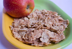 Corn-flakes. Whith red apple Stock Image