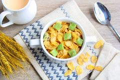 Corn flakes with avocado. And jug of milk stock photo