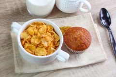 Corn flakes with avocado. And jug of milk royalty free stock photo