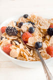 Corn flakes and berry fruits. On the bowl,selective focus Royalty Free Stock Photos