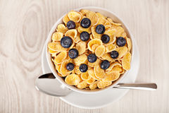 Corn flakes with blueberries breakfast Stock Image