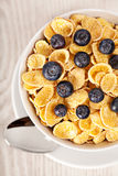 Corn flakes with blueberries breakfast Royalty Free Stock Photo