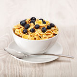 Corn flakes with blueberries breakfast Royalty Free Stock Photography