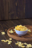 Corn flakes in bowl - cereal breakfast. Royalty Free Stock Photos