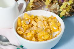 Corn flakes in a bowl with fresh milk Royalty Free Stock Photo