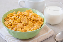 Corn flakes in bowl and glass of milk Royalty Free Stock Images