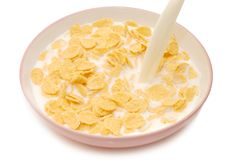 Corn flakes in bowl with milk Royalty Free Stock Image