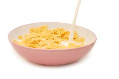 Corn flakes in bowl with milk Royalty Free Stock Photos