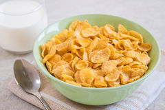 Corn flakes in bowl and milk glass Stock Photo