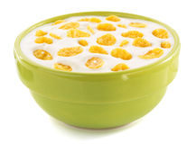 Corn flakes in bowl on white Royalty Free Stock Photography