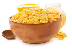 Corn flakes in bowl on white Stock Photos