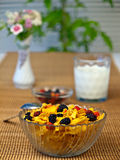 Corn Flakes Breakfast. With flowers and plant stock photo
