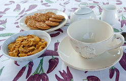 Corn flakes for breakfast. Set for breakfast with cereals and cookies Stock Photo