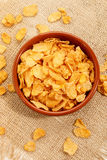 Corn flakes in a brown bowl Royalty Free Stock Photos
