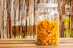 Corn flakes in container Royalty Free Stock Image