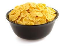 Corn Flakes in der Schüssel auf Weiß Stockbild