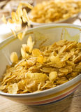 Corn flakes falling in bowl Royalty Free Stock Image