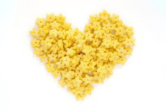 Corn Flakes in the form Heart Isolated Top View. On White Background Stock Photo