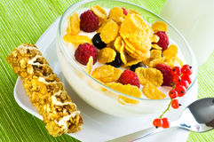 Corn flakes and fresh berries Stock Images