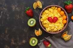 Corn flakes with fresh berries and fruits. Top view, space for text. Stock Photography