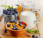 Corn flakes with fresh berries and milk Stock Photos
