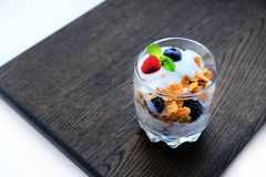 Corn flakes with fresh berries and mint leaf Stock Images