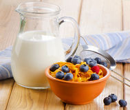Corn flakes with fresh blueberries and milk Royalty Free Stock Image