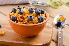 Corn flakes with fresh blueberries Stock Images