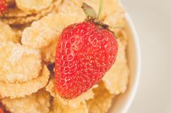 Corn flakes with fresh strawberry/corn flakes with fresh strawberry closeup. Top view stock images