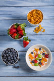 Corn flakes with fruit for breakfast Royalty Free Stock Photo